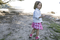Little girl standing on the beach - KMKF00215
