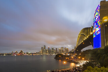 Australia, New South Wales, Sydney, Skyline with Sydney Opera House and Sydney Harbour Bridge in the evening - MKF00340