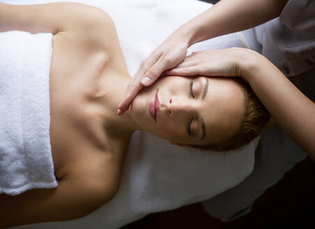 Woman receiving massage from female therapist in spa - CAVF45580