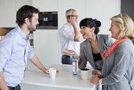 Business people having friendly conversation during coffee break - MASF06615