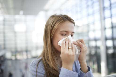 Young woman blowing nose - PNEF00611