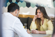 Young woman looking at man in a cafe - DIGF03927