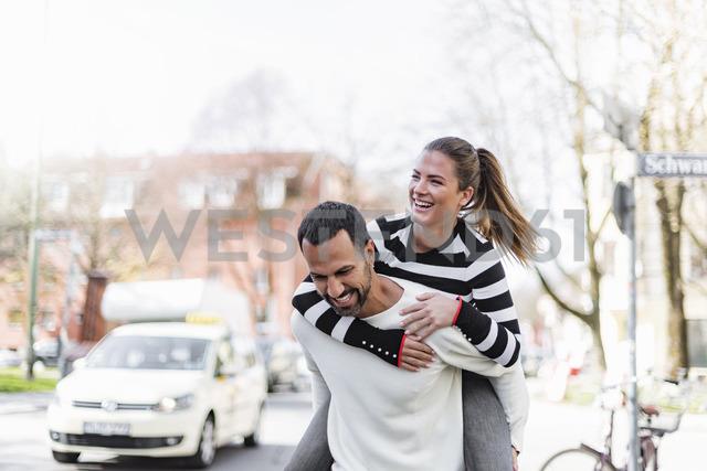 Happy couple having fun outdoors - DIGF03966