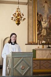 Priest standing in church - MASF06670