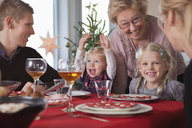 Happy family at dinner table - MASF06729