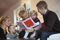 Family reading a book - MASF06735