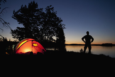 Man and tent - MASF06741