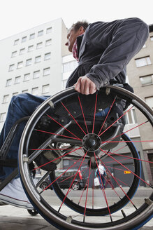 Low angle view of man in wheel chair - MASF06762