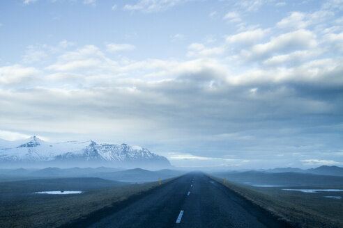 Empty country road against cloudy sky during foggy weather - CAVF45839