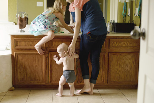 Mother with children in bathroom at home - CAVF45992