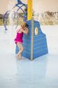 Full length of girl in swimwear enjoying at water park - CAVF46055