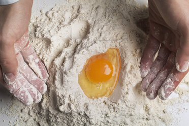 Cropped image of man preparing dough - CAVF46154