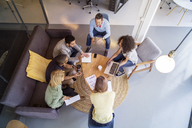 High angle view of business people discussing in meeting at office - CAVF47176