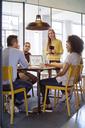 Business people brainstorming in board room at office - CAVF47185