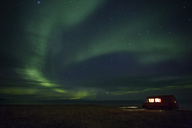 Illuminated van parked at sea shore against Aurora Borealis - CAVF47344