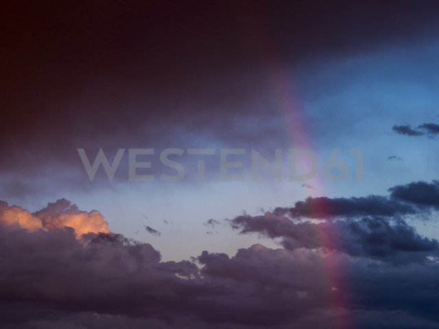 Austria, Hoersching, dark clouds after thunderstorm and rainbow - EJWF00872