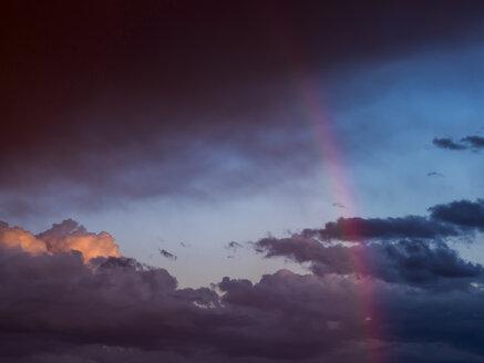 Austria, Hoersching, dark clouds after thunderstorm and rainbow - EJWF00872