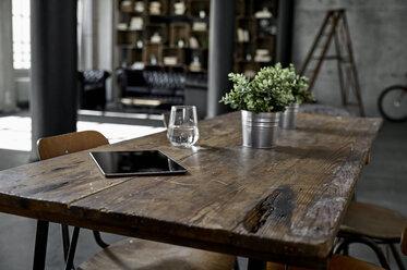 Tablet on table in loft flat - PDF01579