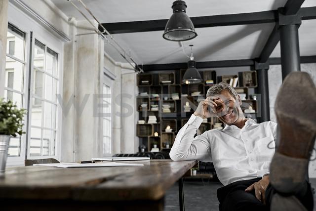 Portrait of mature businessman laughing - PDF01609
