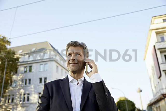 Mature businessman on smartphone in the city - PDF01621