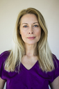 Portrait of blond mature woman wearing purple top - MOEF01045