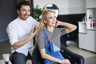 Happy woman at the hairdresser - ABIF00344