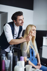 Hairdresser advising his customer - ABIF00347