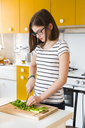 Girl chopping vegetable in the kitchen - LVF06892