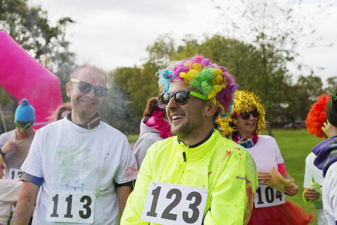 Playful runner in wig at charity run in park - CAIF20325