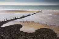 Remote ocean beach with craggy jetty, Heysham, Lancs, UK - CAIF20346