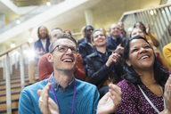Laughing, happy conference audience clapping - CAIF20427