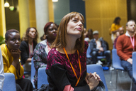 Attentive, focused businesswoman listening in conference audience - CAIF20451