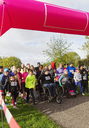 Crowd ready at charity run starting line in park - CAIF20475