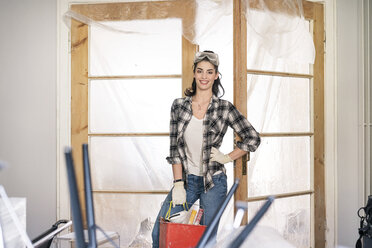 Young woman renovating her new flat - PESF01036