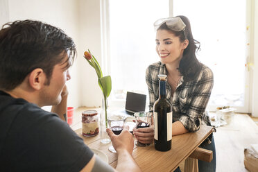 Couple renovating their flat, taking a break, drinking red wine - PESF01042