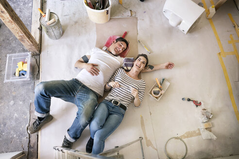 Happy couple renovating new home, taking a break, daydreaming - PESF01057