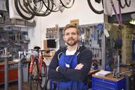 Bicycle mechanic in his repair shop, portrait - LYF00808