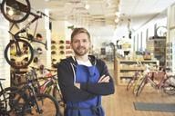 Bicycle mechanic in his repair shop, portrait - LYF00811