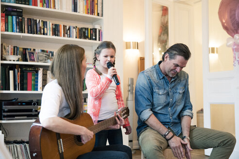 Happy family making music together at home - MOEF01082
