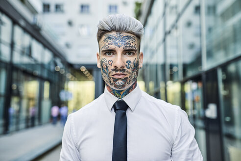 Young businessman with tattooed face, portrait - ZEDF01345