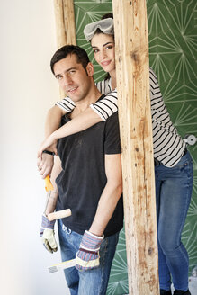 Happy couple renovating their new home - PESF01084