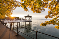 Austria, Vorarlberg, Bregenz, Lake Constance, waterfront promenade, fishing pier at sunset in autumn - WD04597