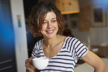 Portrait of relaxed mature woman with cup of coffee at home - PNEF00619