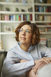 Portrait of pensive mature woman at home - PNEF00631
