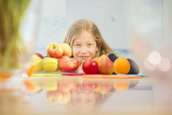 Portrait of smiling girl with various fruits - NEKF00034