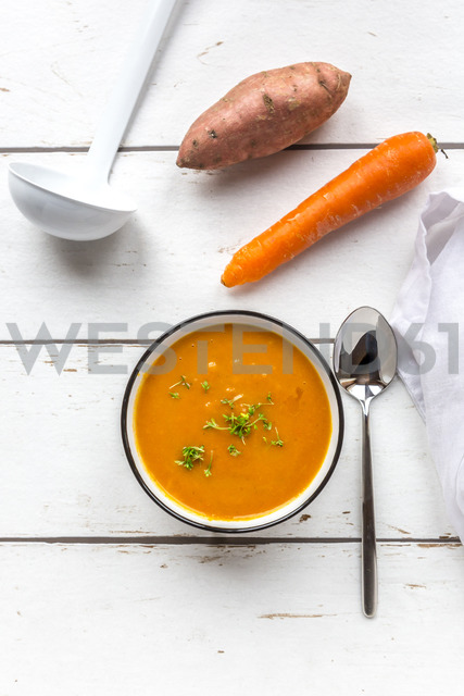 Bowl of sweet potato carrot soup garnished with cress - SARF03682