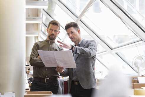 Two businessmen discussing plan in factory - DIGF03992