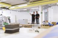 Two men talking in factory - DIGF04022