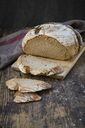 Homemade sourgough rye bread on chopping board - LVF06909