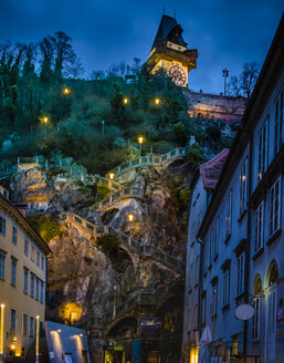 Austria, Styria, Graz, Grazer Schlossberg, castle mountain with staircase, clock tower at night - EJWF00879